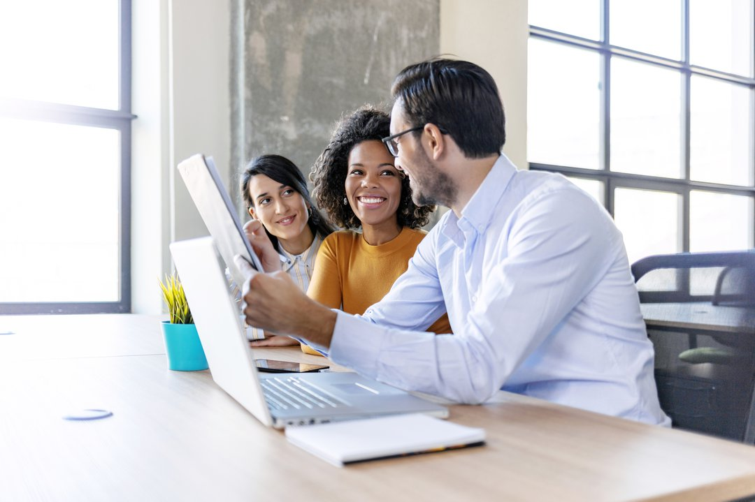 three coworkers on looking at documents