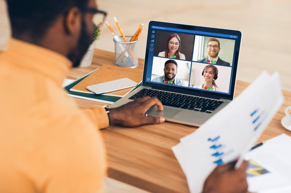 African American employee having online business meeting with colleagues