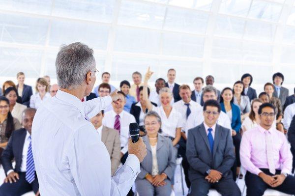 Male leading employee training session