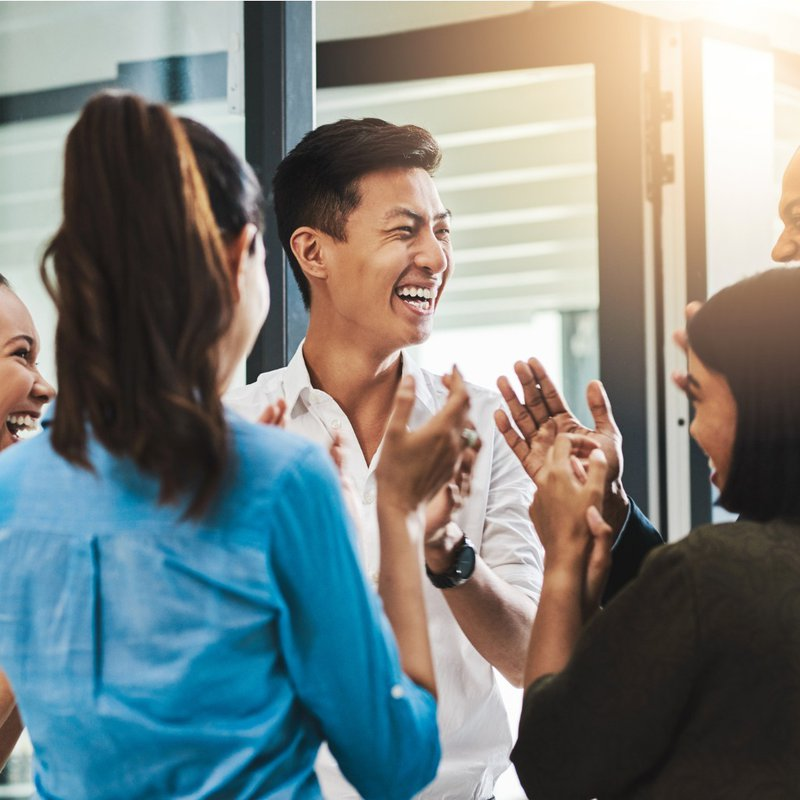 Group of employees clapping