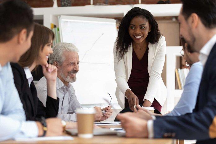 sales team gathered around a meeting table.jpg