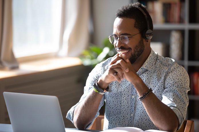 Man happily sharing training metrics virtually