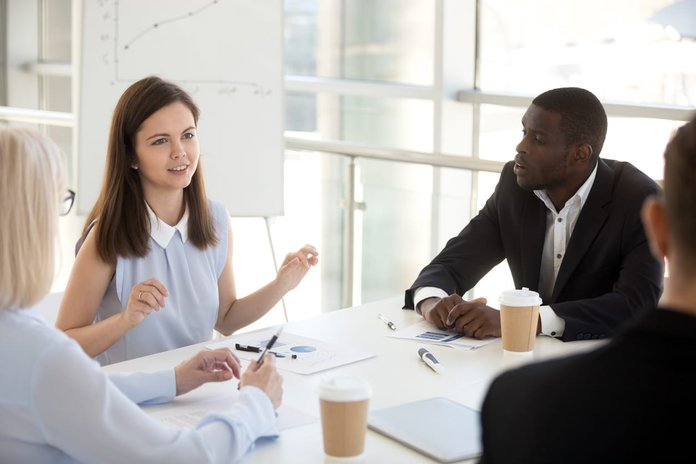 Woman talking to a group of employees