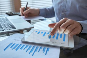 businessman working with financial report charts, business analytics and KPI