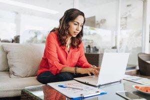 Woman taking an employee training program at home